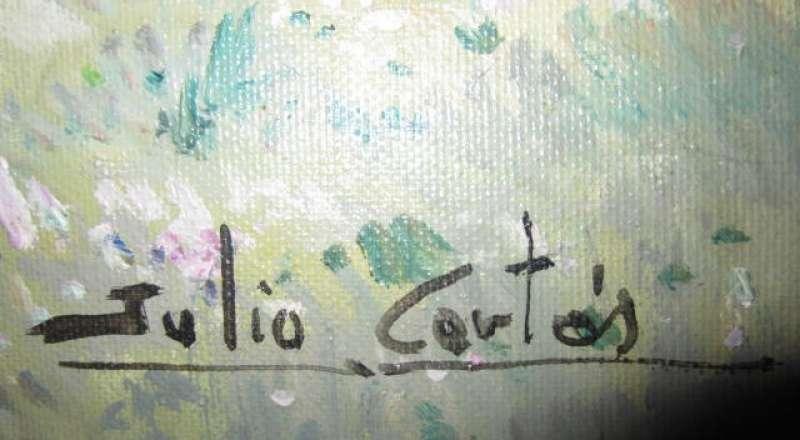 Su firma en una de las obras