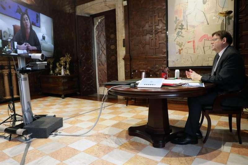 El president de la Generalitat, Ximo Puig, mantiene una videoconferencia con su homóloga balear, Francina Armengol, para hacer seguimiento del actual proceso de desescalada y de las consecuencias de la pandemia. EFE/GVA