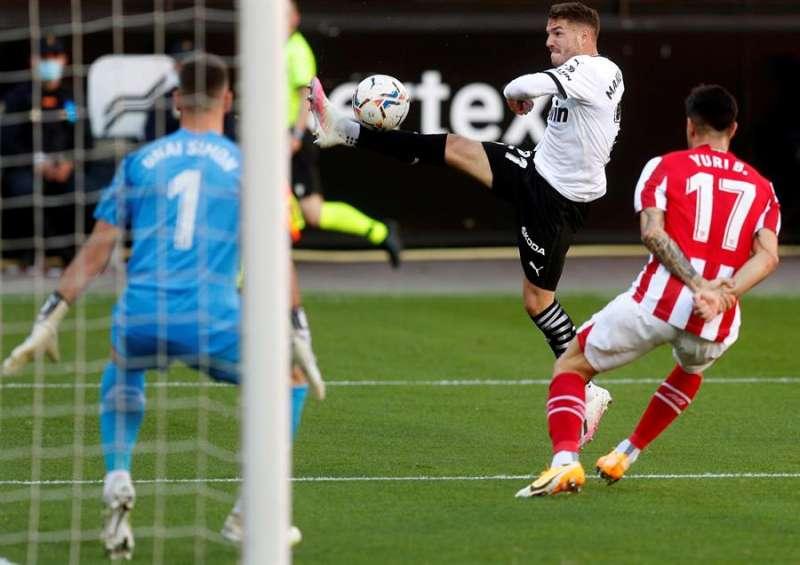 València, 12 dic (EFE).- El Valencia y el Athletic Club empataron a dos goles en Mestalla. EFE